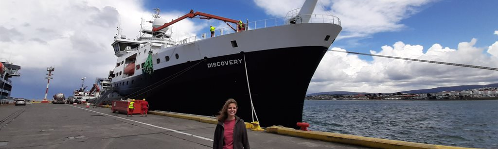 Ophelie Meuriot standing in front of the RRS discovery in port
